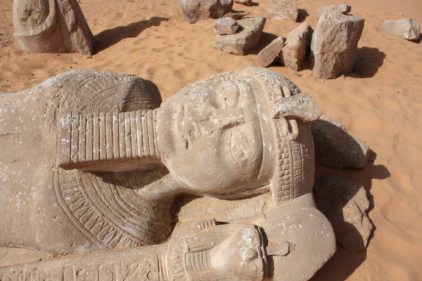 Statue of Rameses II with a missing nose and damaged face